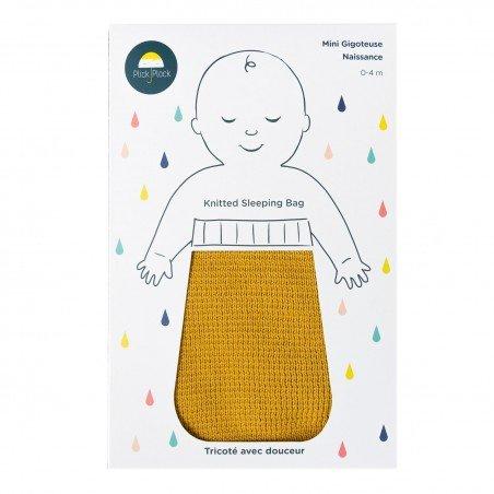Gigoteuse naissance coton moutarde tricoté en coton certifié Oeko Tex 100 dans son packaging