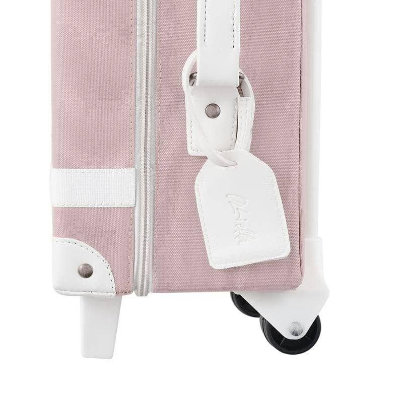 Valise à roulettes rose vue de côté par Olliella