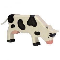 Vache mangeant en bois